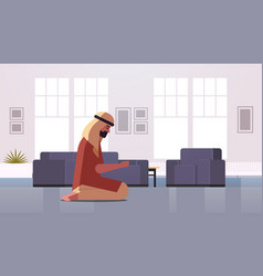 Religious muslim man kneeling and praying at home vector