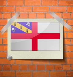 Flags Herm scotch taped to a red brick wall vector