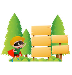 boy and many wooden signs in park vector image