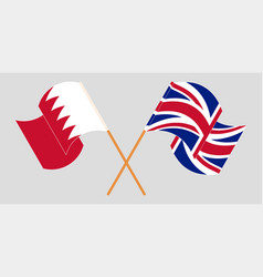 Crossed and waving flags bahrain and uk vector