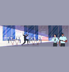 robber in black mask standing raised hands near vector image