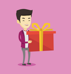 joyful asian man holding box with gift vector image