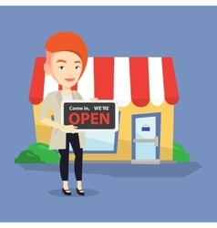 Female shop owner holding open signboard vector image