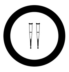 pair of crutches black icon in circle vector image
