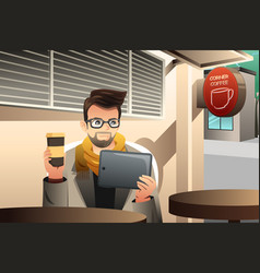 trendy young man using tablet in a cafe vector image