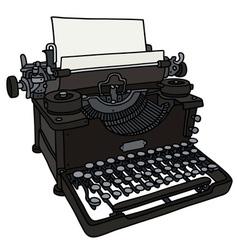 Old black typewriter vector