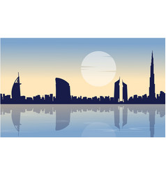 silhouette of dubai skyline with reflection vector image