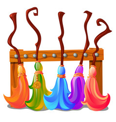 Wooden stand with colorful brooms of the witches vector