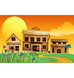 A view of the sunset and the three houses vector image