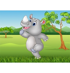 Cartoon funny rhino posing in the jungle vector image vector image