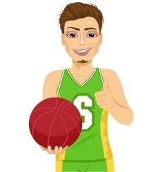 male basketball player holding ball vector image