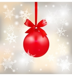 Red shiny ball with a bow on a beautiful Christmas vector image vector image