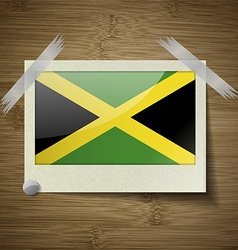 Flags Jamaica at frame on wooden texture vector image