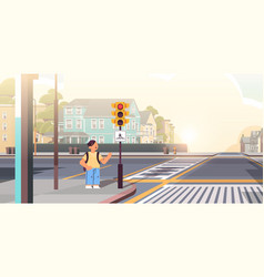 Schoolboy with backpack waiting for green traffic vector