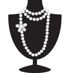 Pearl necklace on black mannequin vector