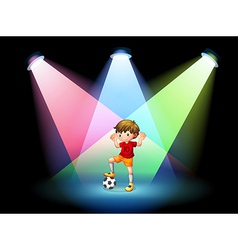 A soccer player at the stage with spotlights vector image