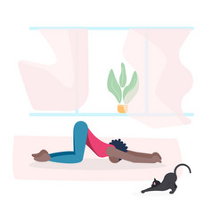 Young woman and her cat do yoga together vector