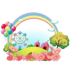 A hill with circus tents balloons and a ferris vector
