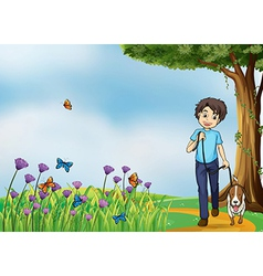 A young boy walking with his pet vector image