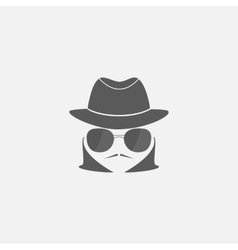 Spy in a hat and sunglasses vector