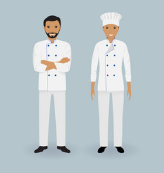 Couple of male and female chefs standing together vector