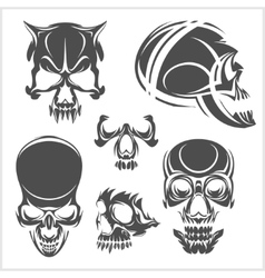 Skulls with tribal elements set vector