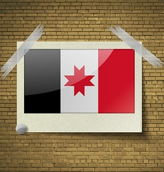 Flags Udmurtiaat frame on a brick background vector image
