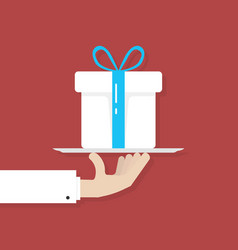 hand holding big white gift box on plate vector image vector image