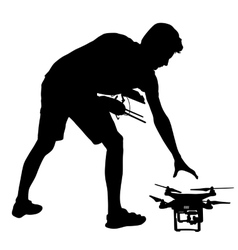 Black silhouette of a man operates unmanned vector image