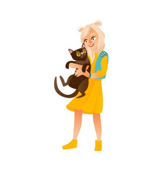 blond teenage girl standing and holding black cat vector image