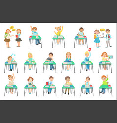 Children sitting at school desks in class vector