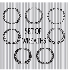 Set of wreaths with laurel leaves and spik vector