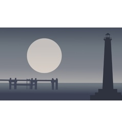 Silhouette of lighthouse on seaside vector