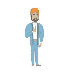 Young hindu businessman giving thumb up vector