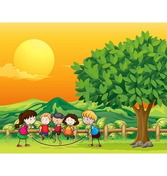 Five children playing jumping rope vector image