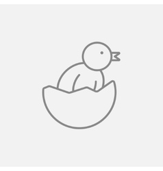 Chick peeking out of egg shell line icon vector image