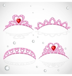 Pink tiaras with diamonds and faceted red stones vector image