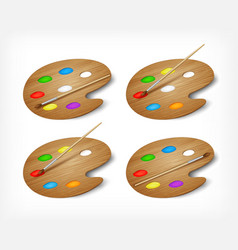 Set wooden art palettes with paints and brush vector image