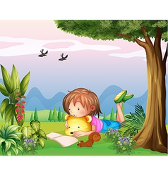 A girl reading at the park vector image
