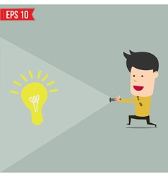 Businessman use flashlight find an idea vector image