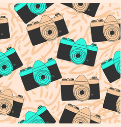 seamless pattern with old photo cameras in doodle vector image