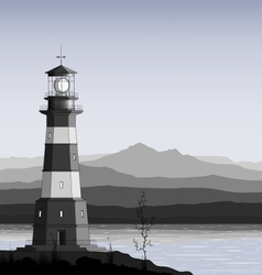 Lighthouse against a mountain range vector image vector image