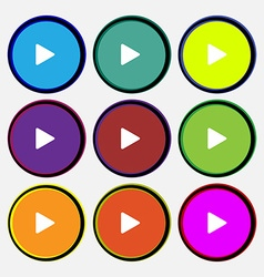 Play icon sign Nine multi-colored round buttons vector