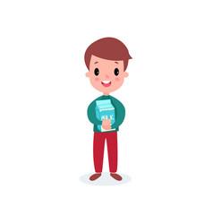 cute smiling boy holding cardboard box of milk vector image