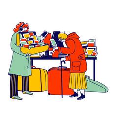 senior lady look vintage postcards on flea market vector image