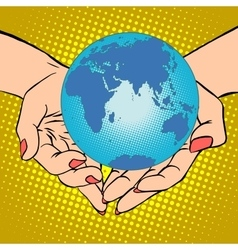 Planet Earth in hands Eurasia Africa Australia vector image