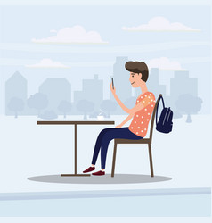 teenager looks in smartphone table in cafe vector image