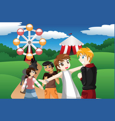 Kids waiting in line in an amusement park vector