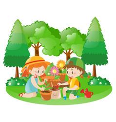 Two kids planting tree in garden vector