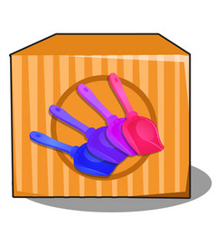 cardboard box with colored plastic shovels for vector image